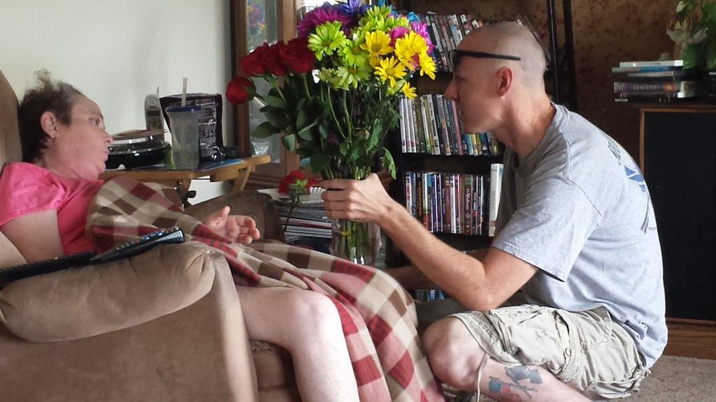 Mom getting flowers from Aaron via Jake.